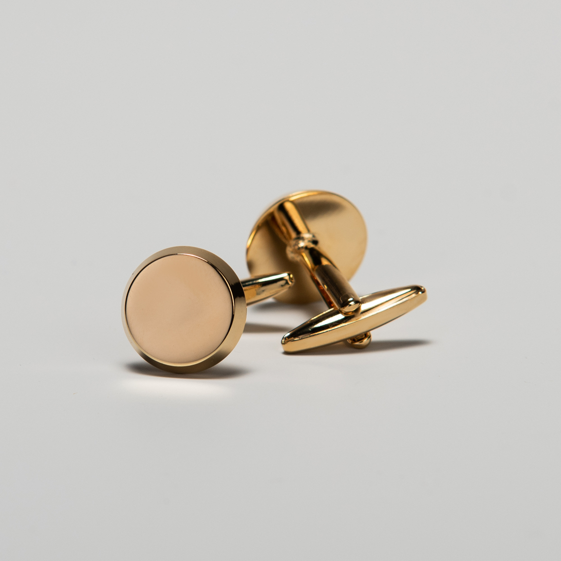 Gold circle cuff links
