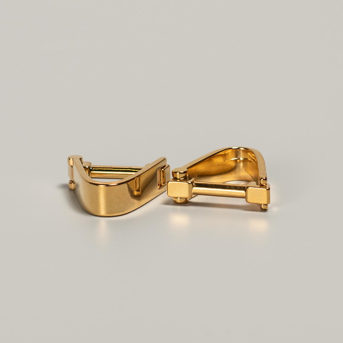 Gold colored cufflinks